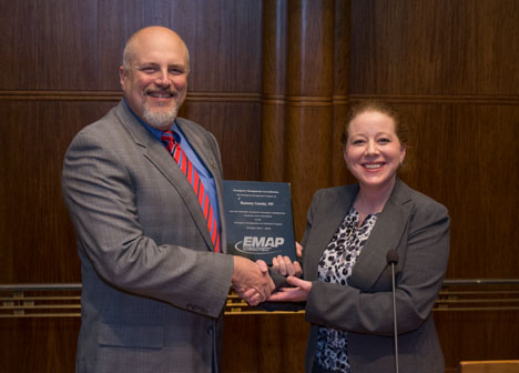 EMAP Executive Director presents certification plaque to Emergency Management director