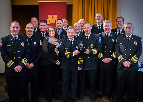 Representatives from Emergency Communications and the Fire Cheif's Association accept award