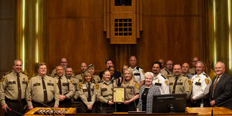 Correctional officers receiving proclamation from Commissioner Reinhardt