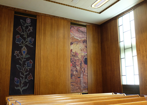 East side view of the murals in council chambers