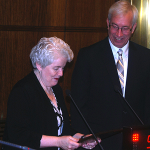 Board of Commissioners Chair Reinhardt presents plaque to outgoing chair McDonough
