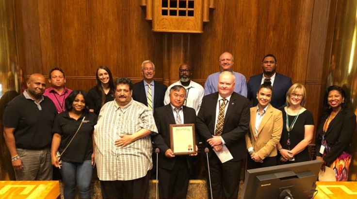 Staff from Community Corrections accepting proclamation