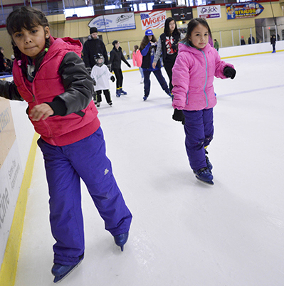 Girls ice skating