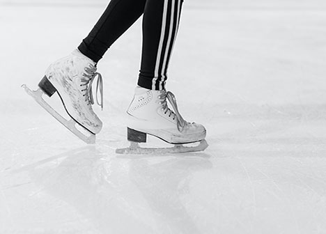Close-up view of someone skating at an ice rink