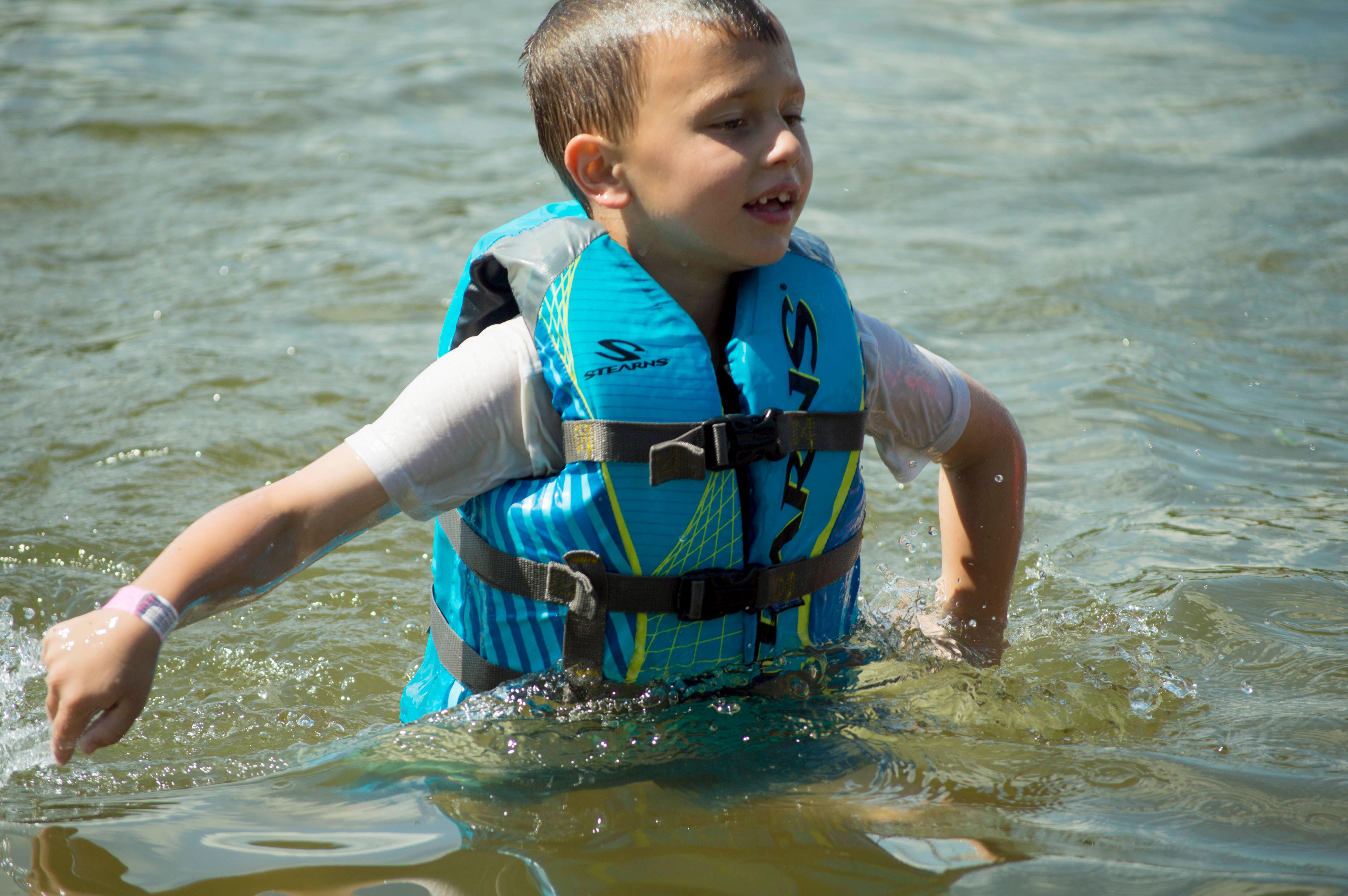 Young boy swimming at Snail Lake Beach