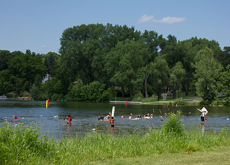 Group of people swimming at Lake McCarrons County beach