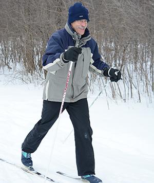 Adult man cross-country skis at Tamarack Nature Center