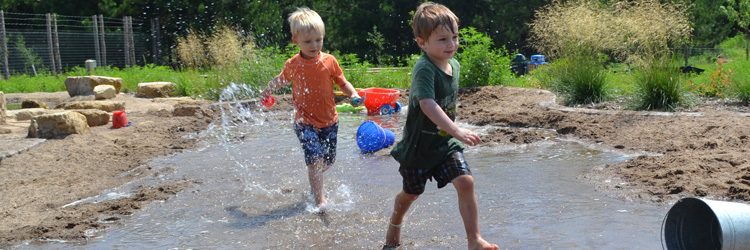 Boys playing in The Stream