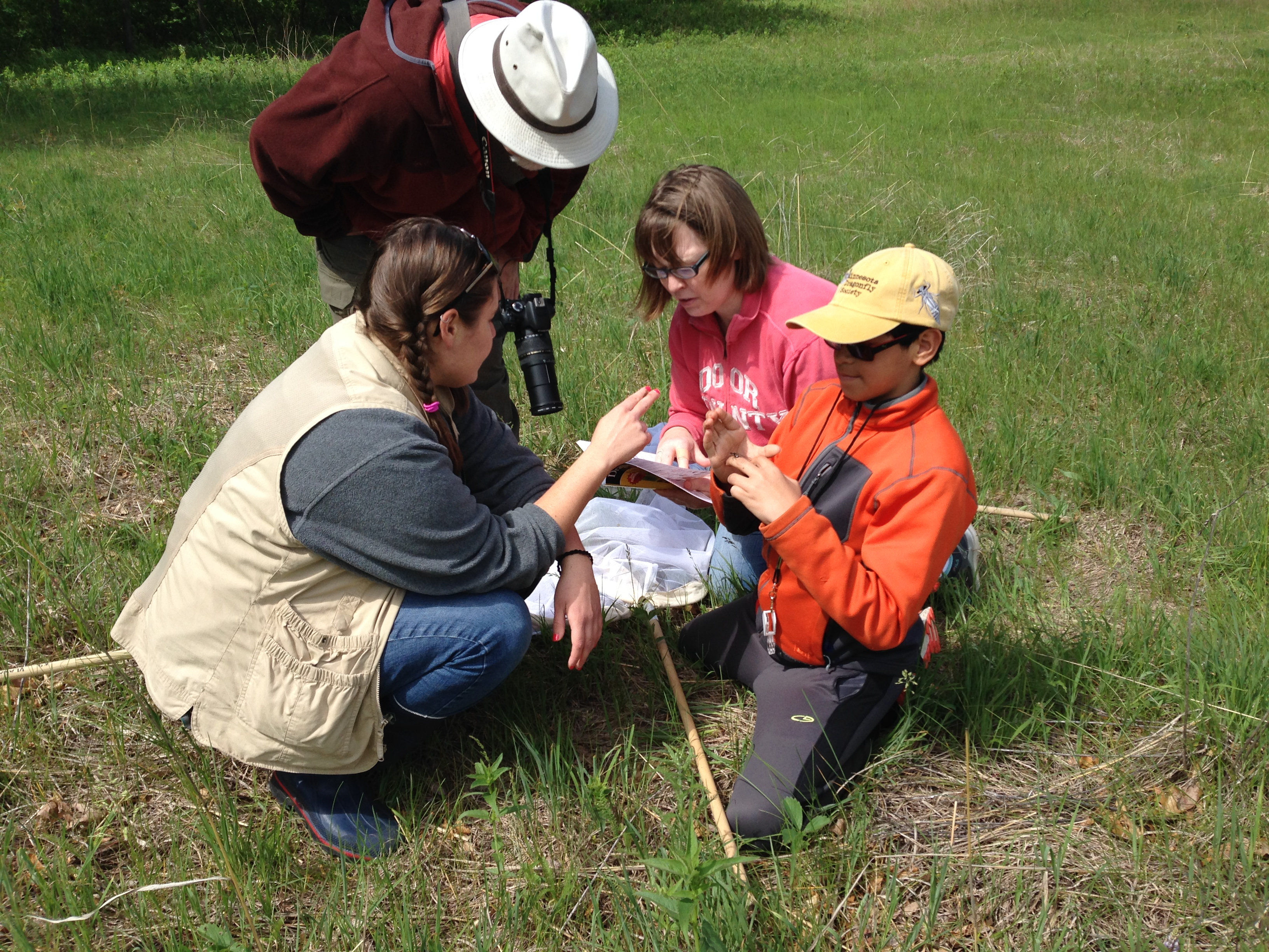 Volunteers assist youth with dragonfly monitoring