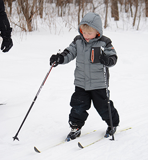 Young boy cross-country skis at Tamarack Nature Center
