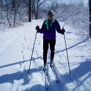 Cross-country skier on country trail