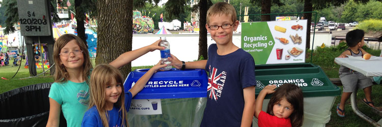 Children using recycling containers