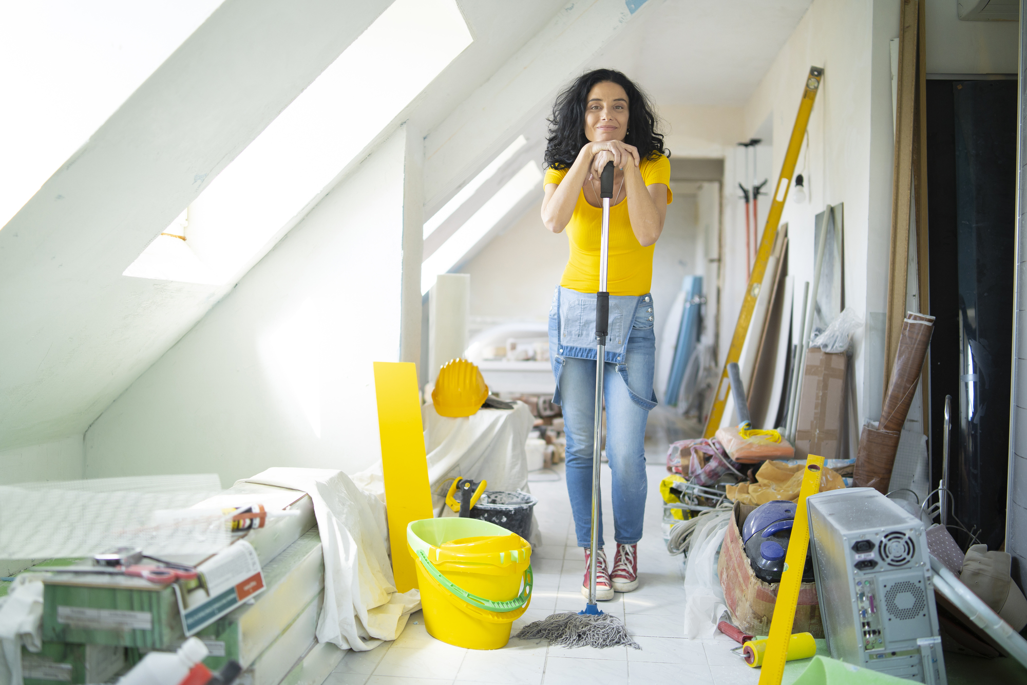 Woman cleaning an indoor space.