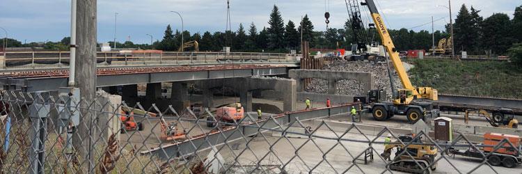 Construction crews removing beam from Dale Street bridge