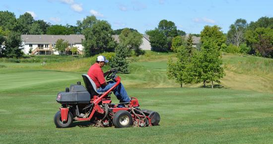 Golf course grass mowing