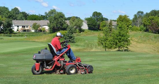 Golf course grass mowing