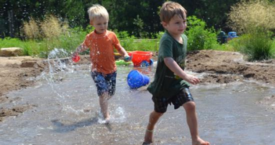 Boys running through The Stream of Discovery Hollow