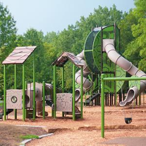 Playground equipment at Battle Creek Regional Park including swings and slides
